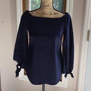 Deep purple off the shoulder shirt/blouse.
